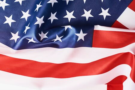 Nahaufnahme von wehenden nationalen usa amerikanische Flagge als Hintergrund. Konzept des Gedenk- oder Unabhängigkeitstages oder 4. Juli