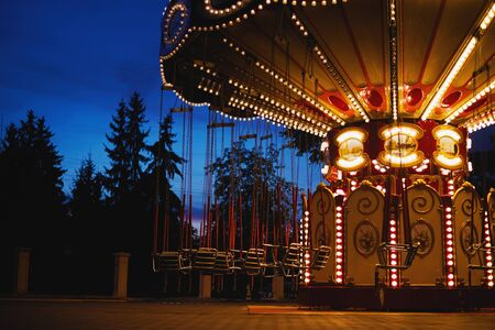 Carousel Merry-go-round in amusement park at night city 스톡 콘텐츠