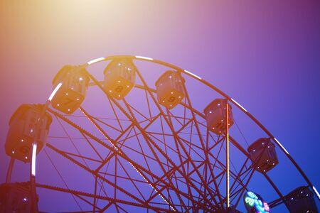 ferris wheel in amusement park at night city