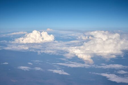 Aerial view of fluffy clouds. Top view of beautiful cloudscape and blue sky