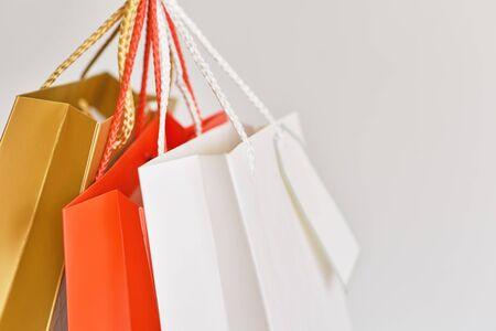 colorful paper shopping bag on white background, close up Reklamní fotografie
