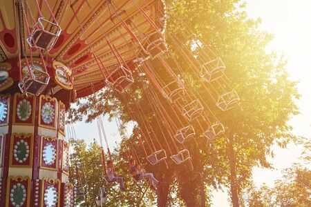 Chain carousel merry-go-round in amusement park