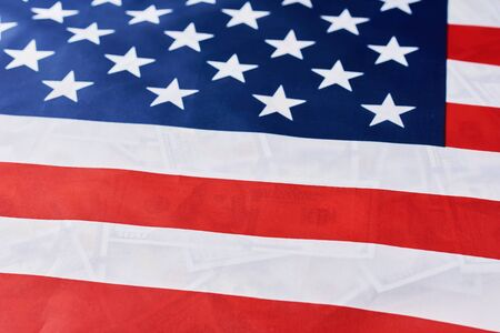 Close up of american flag over usd dollar bills background. Financial concept Reklamní fotografie
