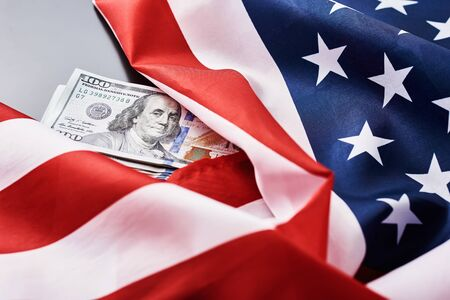 USA national flag and dollar bills. Business and finance concept