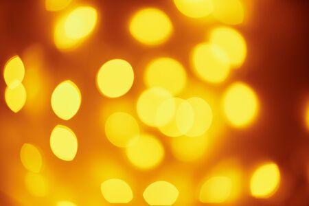 Background of golden lights in bokeh. Defocused abstract blurred lights