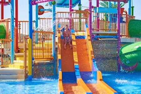 Colorful slides in waterpark close up. Aquapark sliders with pool Reklamní fotografie