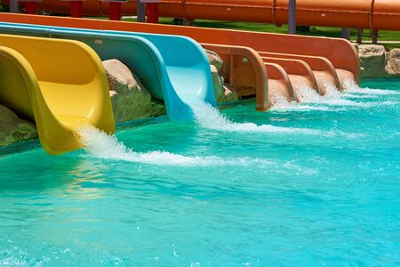 Colorful water slides in aqua park, close up
