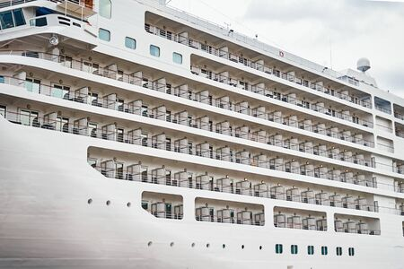 View of balconies of cabins on cruise ship moored in the port