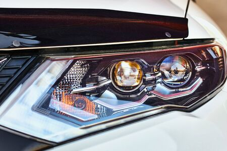Close up of modern car headlight with led lamp