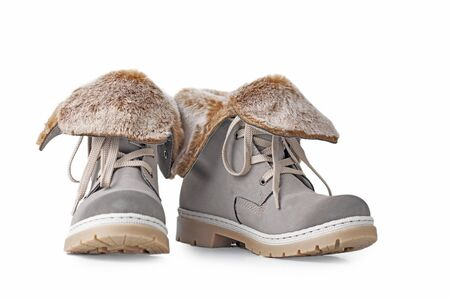 Pair of winter womens boots on white background isolated Standard-Bild