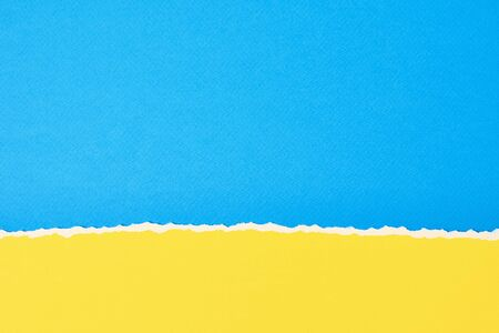 Torn ripped paper edge with copy space, color blue and yellow background