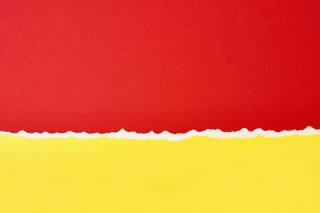 Torn ripped paper edge with copy space, red and yellow color background