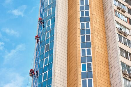 Group of industrial climber work on modern building outdoor