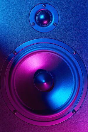 Sound audio speaker with neon lights. Dynamic monitor closeup. Creative backgroound Archivio Fotografico