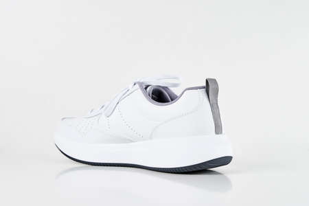 White male sneaker on a white background isolated. Fashion stylish sport shoes, close up