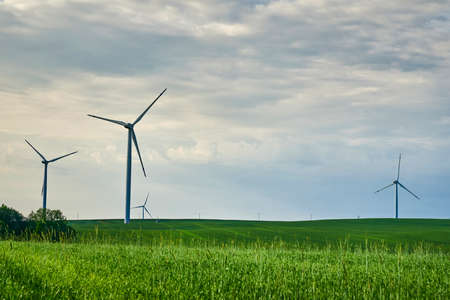 Wind turbine in the field. Wind power energy concept. Renewable energy for climate protection