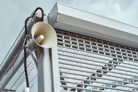 Public megaphone on building construction. Speaker for announcing outdoor