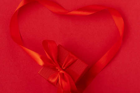 Valentine's Day background. Hearts on the red background. Valentine day concept. Top view, flat lay Imagens