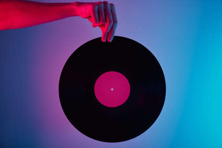 Hand hold retro vinyl disc with neon lights