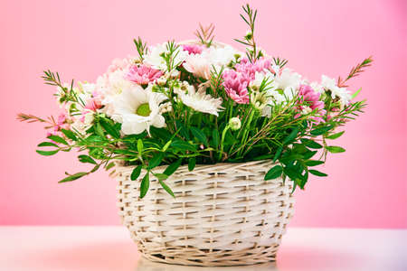 Bunch of fresh summer flowers on pink background