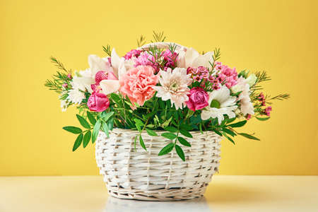 Bunch of fresh summer flowers on yellow background Zdjęcie Seryjne