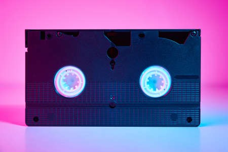 Video cassete on color background. Retro vhs cassette tape, close up Zdjęcie Seryjne