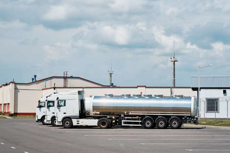 Trucks with tank trailer on parking lot