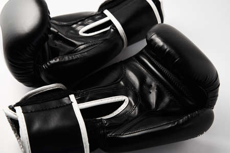 Pair of black boxing gloves on white background, closeup Zdjęcie Seryjne