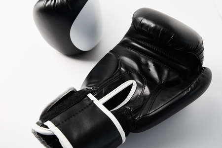 Pair of black boxing gloves on white background, closeup Stock Photo