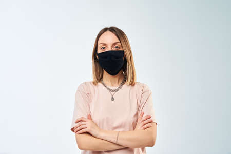 Woman portrait with protective mask on face on white background