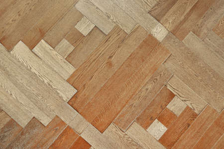 Wooden floor with pattern made of thin planks. Parquet background