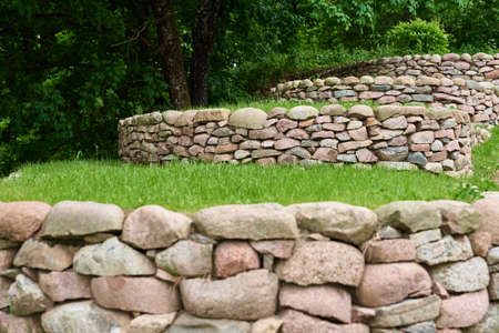 Stones and green grass, front yard. Landscape design