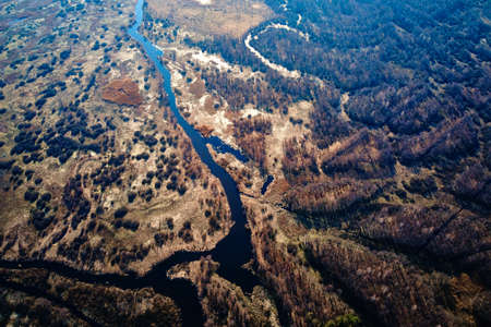 Aerial drone view of river in valley. Natural landscape