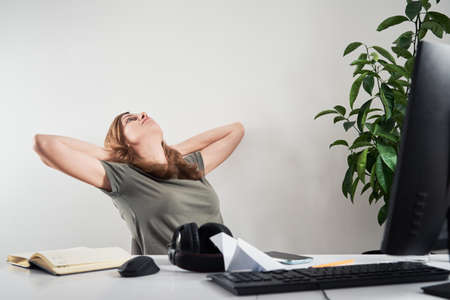 Woman procrastinate on remote work at home workplace. Online work and home office problem