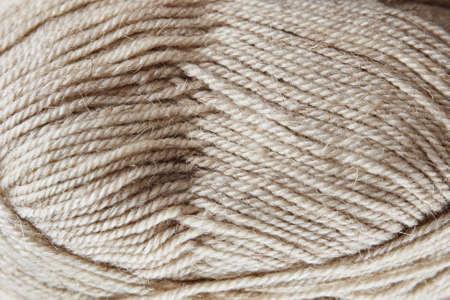 Skein of woolen yarn on a wooden background