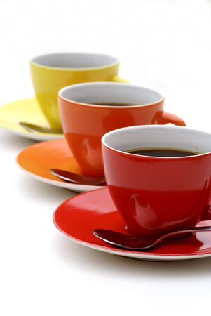 teaset: Three cups of coffee standing in line. Stock Photo