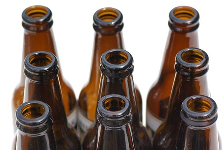 bottlenecks: Nine empty isolated beer bottles.