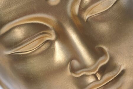 Diagonal close up of golden buddha face.                 Stock Photo - 1365069