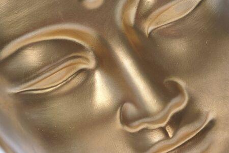 Diagonal close up of golden buddha face. Stock Photo - 1365069