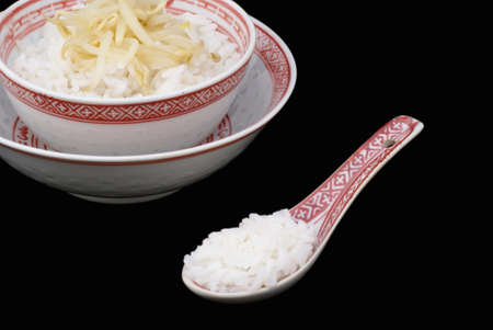 Chinese bowl with rice against black background. Stock Photo - 1412603