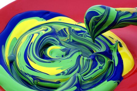 Three colors of paint, mixed together. Stock Photo - 1480081