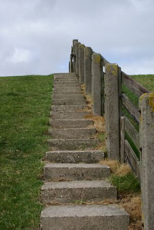 dike: Stairway to get on top of a dike. Stock Photo