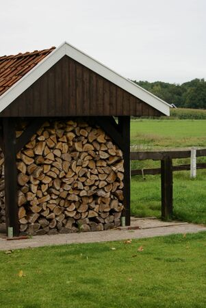 woodshed: Wood-shed with field in the background.