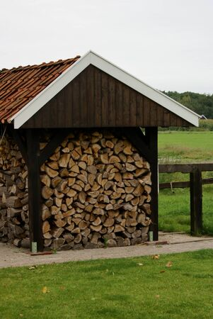woodshed: A woodshed next to a field. Stock Photo