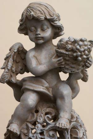 fruit basket: Isolated angel with fruit basket.