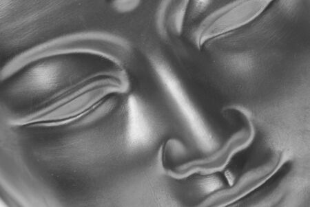 Close up of the face of a buddha in black and white. Stock Photo