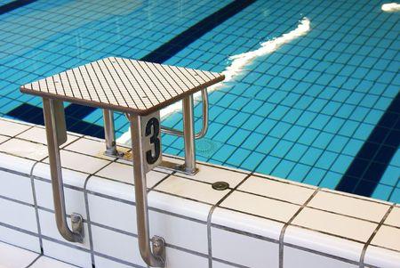 swimmingpool: Starting block in an indoor swimming pool.