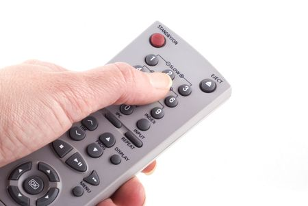 Hand with remote control isolated on white. photo