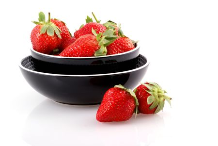 Bowl full of strawberries isolated on white. photo