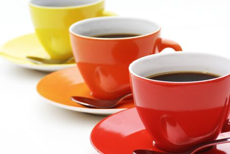 teaset: Three cups of coffe in diagonal line. Stock Photo